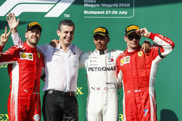LTR: Sebastian Vettel, Ferrari, Mercedes Team Member, Lewis Hamilton, Mercedes AMG F1 and Kimi Raikkonen, Ferrari.