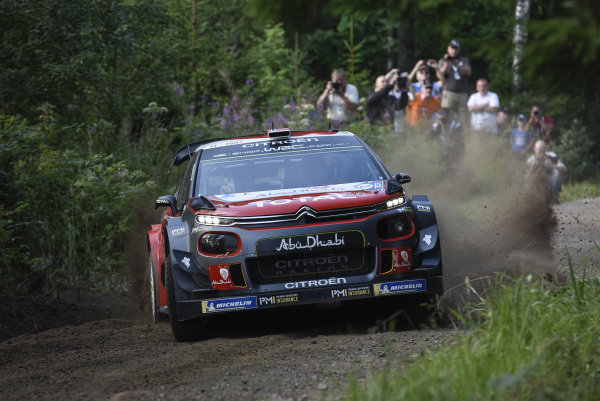 Sliding in the forests of Rally Finland, Mads Ostberg in his Citroen C3 WRC