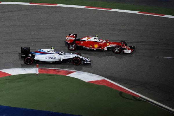 Valtteri Bottas (FIN) Williams FW38 and Kimi Raikkonen (FIN) Ferrari SF16-H battle at Formula One World Championship, Rd2, Bahrain Grand Prix Race, Bahrain International Circuit, Sakhir, Bahrain, Sunday 3 April 2016.