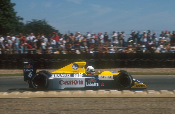 1990 British Grand Prix.Silverstone, England.13-15 July 1990.Riccardo Patrese (Williams FW13B Renault). He was hit by Nannini on lap 15 then pitted for repairs, but he exited the race after his undertray disintegrated.Ref-90 GB 23.World Copyright - LAT Photographic