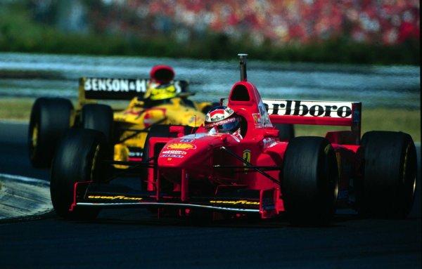 1997 Hungarian Grand Prix.Hungaroring, Budapest, Hungary.8-10 August 1997.Michael Schumacher (Ferrari F310B) leads brother Ralf (Jordan 197 Peugeot).World Copyright - Coates/LAT Photographic