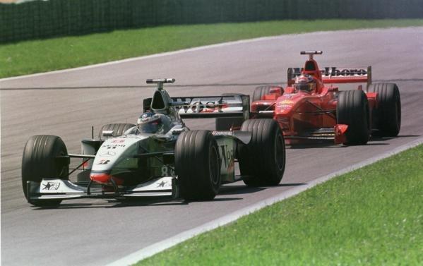 1998 Austrian Grand Prix.A1-Ring, Zeltweg, Austria.24-26 July 1998.Mika Hakkinen (McLaren MP4/13 Mercedes-Benz) leads Michael Schumacher (Ferrari F300). Hakkinen finished in 1st position.World Copyright - LAT Photographic