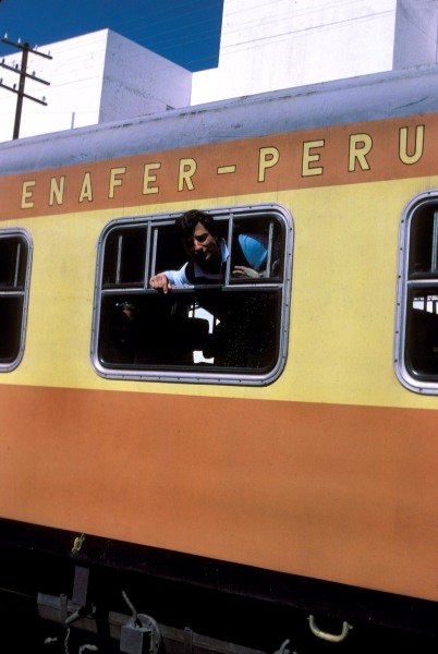 Riccardo Patrese leans from a train windo, while on holiday in Peru, 1983