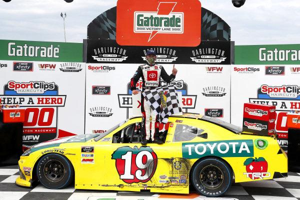 #19: Brandon Jones, Joe Gibbs Racing, Toyota Supra 03 Dash Championship celebrates in victory lane