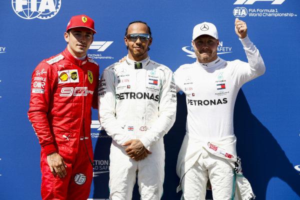 Charles Leclerc, Ferrari, Pole Sitter Lewis Hamilton, Mercedes AMG F1 and Valtteri Bottas, Mercedes AMG F1 celebrate in Parc Ferme