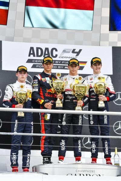 Roman Stanek, Dennis Hauger, race winner Arthur Leclerc, and Theo Pourchaire, on the German F4 podium