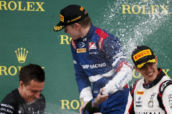 Robert Shwartzman (RUS) PREMA Racing and Leonardo Pulcini (ITA) Hitech Grand Prix celebrate on the podium with the champagne