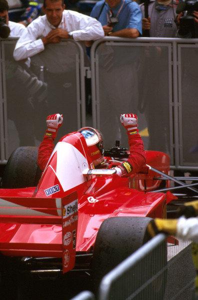 Magny-Cours, France.27-29 June 1997.Michael Schumacher (Ferrari F310B) 1st position. Celebrates victory in parc ferme.Ref-97 FRA 08.World  Copyright - LAT Photographic