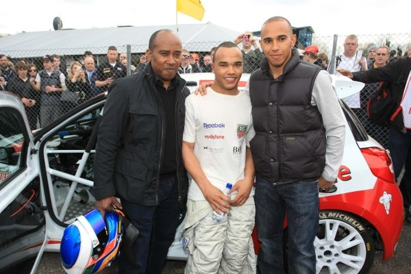 Nicolas Hamilton (GBR), Total Control Racing, centre, with brother Lewis Hamilton (GBR), McLaren, right, and father Anthony Hamilton (GBR), left. Renault Clio Cup, Rd1, Brands Hatch, England, 3 April 2011.