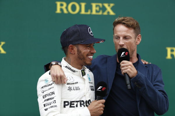 Silverstone, Northamptonshire, UK.  Sunday 16 July 2017. Lewis Hamilton, Mercedes AMG, 1st Position, is interviewed by Jenson Button, McLaren, on the podium. World Copyright: Glenn Dunbar/LAT Images  ref: Digital Image _X4I8337