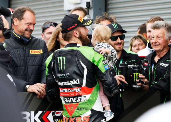 2015 World Superbike Championship.  Donington Park, UK.  23rd - 24th May 2015.  Tom Sykes, Kawasaki, celebrates in parc ferme with his baby girl.  Ref: KW7_7166a. World copyright: Kevin Wood/LAT Photographic
