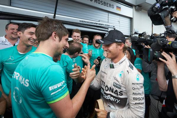 Red Bull Ring, Spielberg, Austria. Sunday 21 June 2015. Nico Rosberg, Mercedes AMG, 1st Position, celebrates with his team. World Copyright: Steve Etherington/LAT Photographic. ref: Digital Image SNE25057