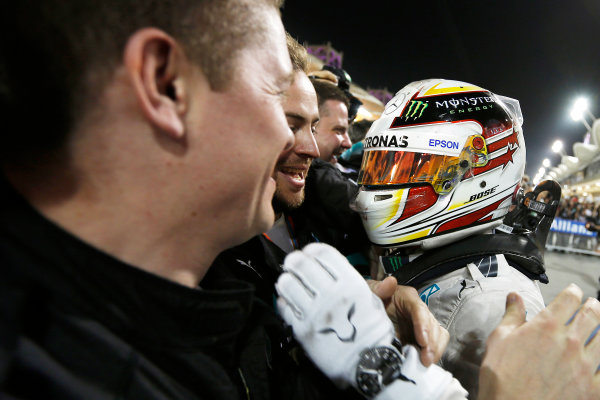Bahrain International Circuit, Sakhir, Bahrain. Sunday 19 April 2015. Lewis Hamilton, Mercedes AMG, 1st Position, celebrates in Parc Ferme with his team. World Copyright: Charles Coates/LAT Photographic. ref: Digital Image _J5R1133