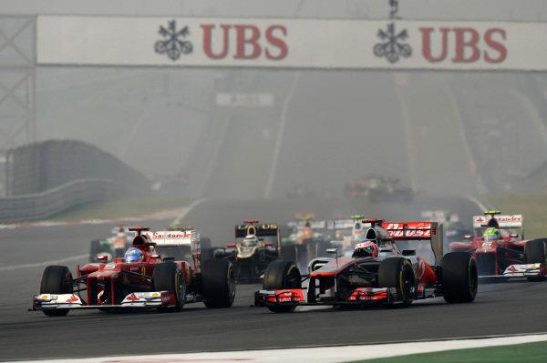 (L to R): Fernando Alonso (ESP) Ferrari F2012 overtakes Jenson Button (GBR) McLaren MP4-27. Formula One World Championship, Rd17, Indian Grand Prix, Buddh International Circuit, Greater Noida, New Delhi, India, Race, Sunday 28 October 2012.   BEST IMAGE