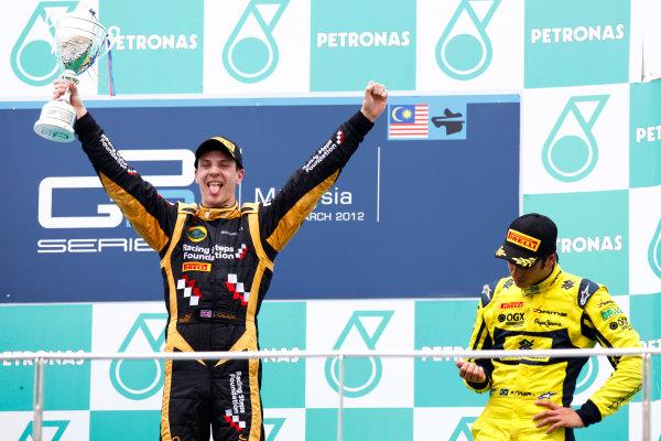 Sepang, Kuala Lumpur, Malaysia. 25th March 2012. Sunday Race.James Calado (GBR, Lotus GP) celebrates his victory on the podium. World Copyright: Alastair Staley/GP2 Series Media Service.Ref: Digital Image AS5D7679.jpg