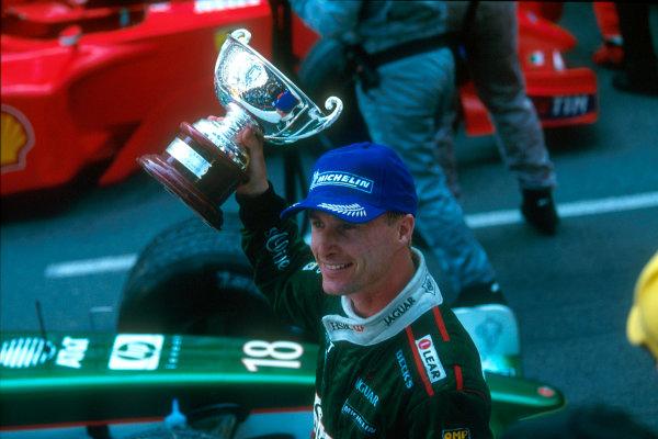 Monte Carlo, Monaco. 29th May 2001. Michael Schumacher, Ferrari F2001.Eddie Irvine, jaguar R2, 3rd place finish.ref: 35mm Priority Image 01MON11