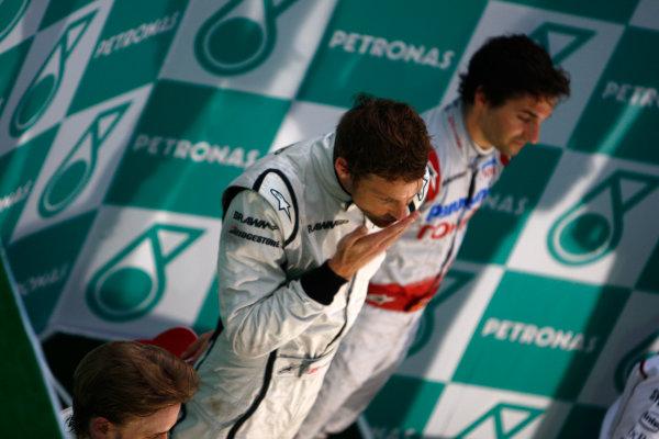 Sepang, Kuala Lumpur, Malaysia5th April 2009Jenson Button, Brawn GP BGP001 Mercedes blows a kiss on the podium.World Copyright: Steven Tee/LAT Photographicref: Digital Image _95U0118