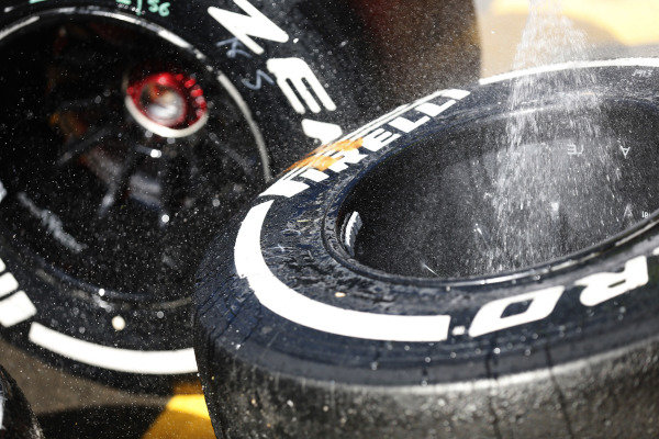 Circuit de Catalunya, Barcelona, Spain. Sunday 10 May 2015. Tyres are washed in the paddock. World Copyright: Alastair Staley/LAT Photographic. ref: Digital Image _79P1002