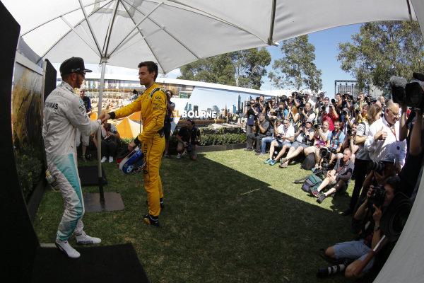 Lewis Hamilton (GBR) Mercedes AMG F1 and Jolyon Palmer (GBR) Renault Sport F1 Team  at Formula One World Championship, Rd1, Australian Grand Prix, Preparations, Albert Park, Melbourne, Australia, Thursday 17 March 2016.