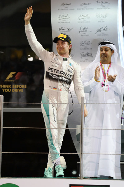 Race winner Nico Rosberg (GER) Mercedes AMG F1 celebrates on the podium at Formula One World Championship, Rd19, Abu Dhabi Grand Prix, Race, Yas Marina Circuit, Abu Dhabi, UAE, Sunday 29 November 2015.