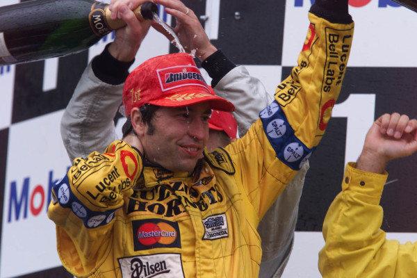 1999 French Grand Prix.Magny-Cours, France.25-27 June 1999. Heinz-Harald Frentzen (Jordan Mugen Honda) celebrates his 1st position on the podium.World Copyright - Lawrence/LAT Photographic
