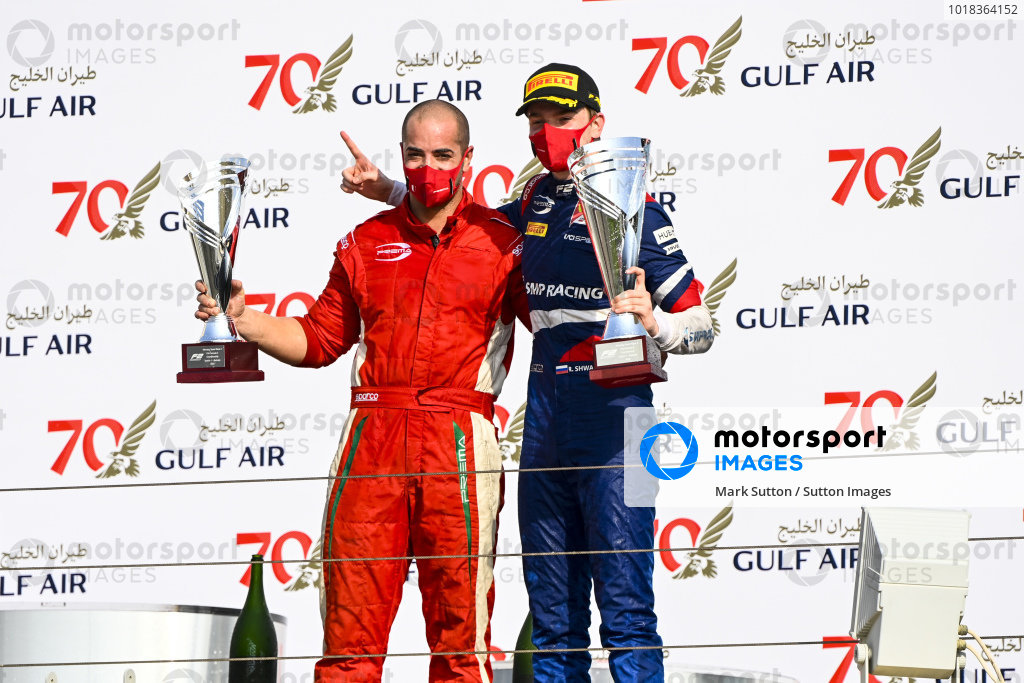 Winning Constructor Representative and Race Winner Robert Shwartzman (RUS, PREMA RACING) celebrate on the podium with the trophy