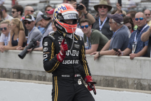 James Hinchcliffe, Arrow Schmidt Peterson Motorsports Honda, mimics a gun slinger after winning a round of the pit stop competition