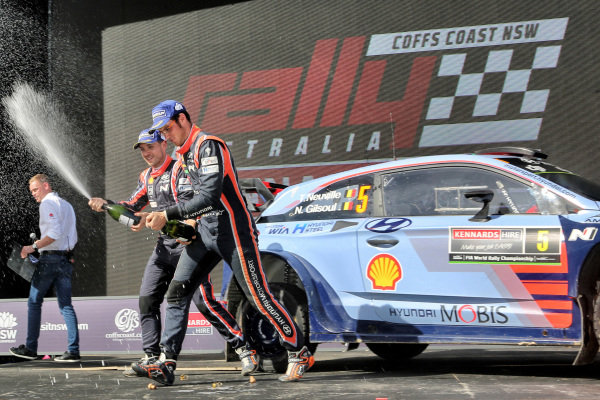 Rally winners Thierry Neuville (BEL) / Nicolas Gilsoul (BEL), Hyundai Motorsport i20 Coupe WRC celebrate on the podium with the champagne at World Rally Championship, Rd13, Rally Australia, Day Three, Coffs Harbour, New South Wales, Australia, 19 November 2017.