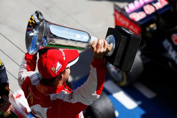 Hungaroring, Budapest, Hungary. Sunday 26 July 2015. Sebastian Vettel, Ferrari, 1st Position, with his trophy. World Copyright: Alastair Staley/LAT Photographic ref: Digital Image _79P0998