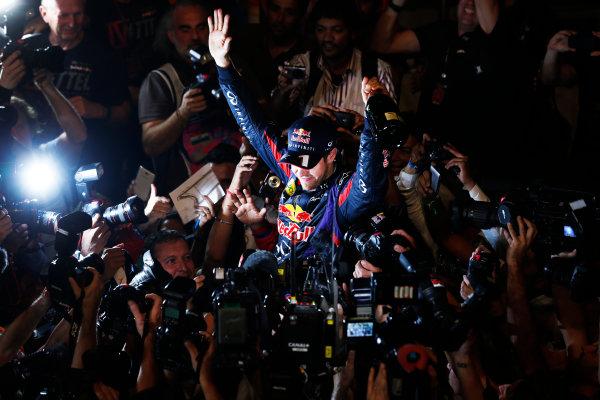 Buddh International Circuit, New Delhi, India. Sunday 27th October 2013. Sebastian Vettel, Red Bull Racing, celebrates. World Copyright: Steven Tee/LAT Photographic. ref: Digital Image _L0U7601