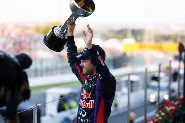 Suzuka Circuit, Suzuka, Japan.  Sunday 13th October 2013. Sebastian Vettel, Red Bull Racing, 1st position, lifts his trophy on the podium.  World Copyright: Steven Tee/LAT Photographic  ref: Digital Image _C3I1211