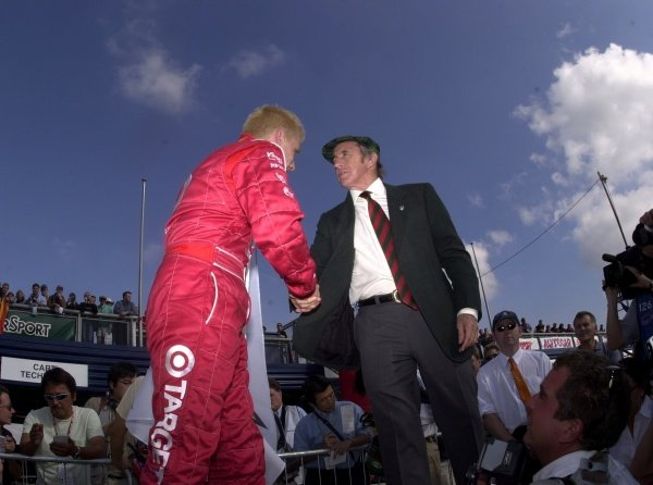 Jackie Stewart congratulates Kenny Brack on winning the pole for the Rockingham 500.  Rockingham Motor Speedway, Corby, GBR.  13  Sept., 2002. CC15A