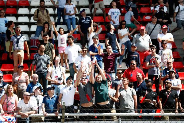 Circuit de Catalunya, Barcelona, Spain. Saturday 13 May 2017. Fans enjoy the atmosphere from the grandstands. World Copyright: Glenn Dunbar/LAT Images ref: Digital Image _X4I7031