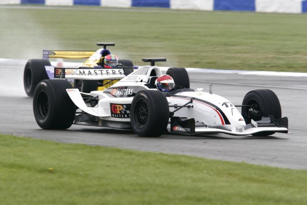 2006 Grand Prix Masters.Silverstone, England. 11th - 13th August.Eddie Cheever battles for the lead with Eric Van De Poele. Action.World Copyright: Drew Gibson/LAT Photographic.Ref: Digital Image Only.