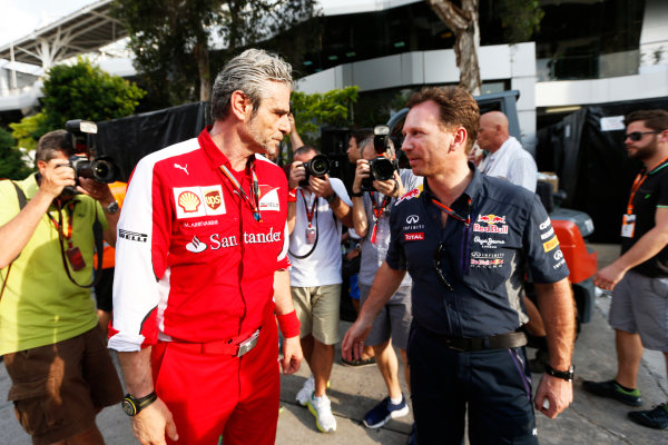 Sepang International Circuit, Sepang, Kuala Lumpur, Malaysia. Sunday 29 March 2015. Mauricio Arrivabene, Team Principal, Ferrari, with Christian Horner, Team Principal, Red Bull Racing. World Copyright: Alastair Staley/LAT Photographic. ref: Digital Image _79P9792
