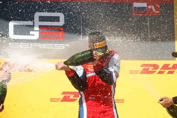 2014 GP3 Series. Round 8.   Sochi Autodrom, Sochi, Russia. Sunday Race 2 Sunday 12 October 2014. Patric Niederhauser (SUI, Arden International) sprays the champagne on the podium. Photo: Glenn Dunbar/GP3 Series Media Service. ref: Digital Image _89P3017