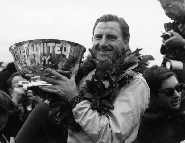 1965 United States Grand Prix.Watkins Glen, New York, USA. 1st-3rd October 1965.Graham Hill, BRM P261, 1st position, podium.World Copyright - LAT Photographic.Ref- B/W Print.