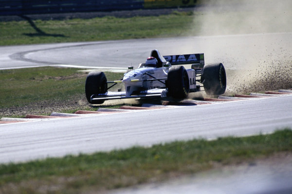 Jos Verstappen, Tyrrell 025 Ford, bounces over the kerbs at the chicane.