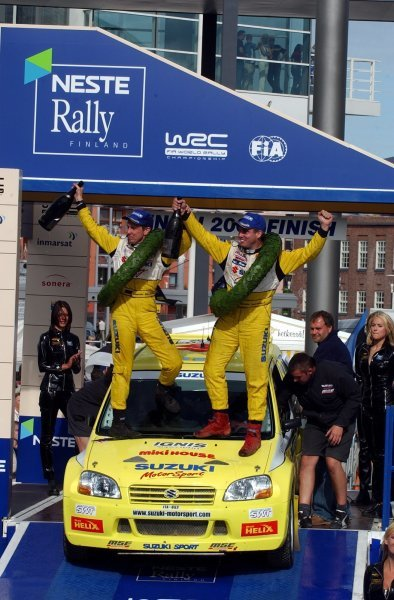 Daniel Carlsson (SWE), right, and co-driver Mattias Andersson (SWE), left, celebrate victory in the Super 1600 Championship on 2003 Rally Finland. 