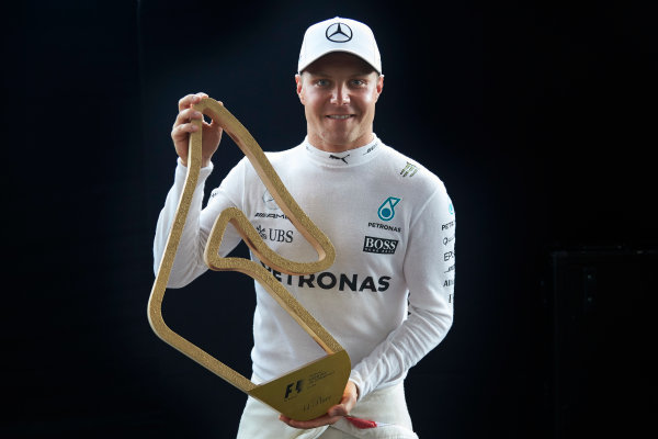 Red Bull Ring, Spielberg, Austria. Sunday 9 July 2017. Valtteri Bottas, Mercedes AMG, 1st Position, with his trophy. World Copyright: Steve Etherington/LAT Images ref: Digital Image SNE19025