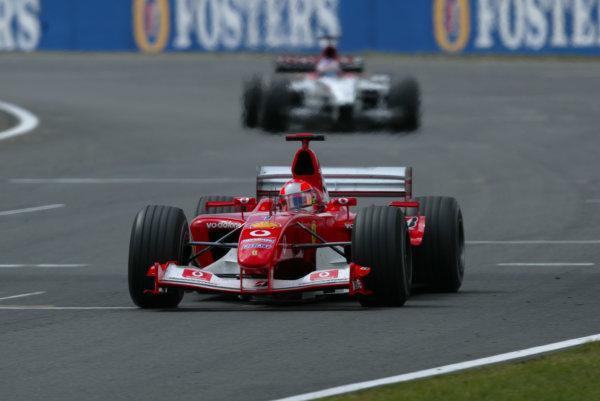 2003 British Grand Prix - Sunday race, Silverstone, England.20th July.Michael Schumacher, Ferrari F2003 GA, leads Jenson Button, B-A-R Honda 005, action.World Copyright LAT Photographic.Digital Image Only.