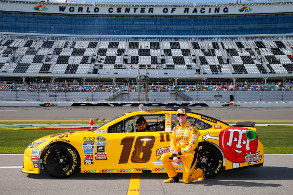 13-21 February, 2016, Daytona Beach, Florida USA   Kyle Busch, driver of the #18 M&M's 75 Toyota, poses with his car after qualifying for the NASCAR Sprint Cup Series Daytona 500 at Daytona International Speedway on February 14, 2016 in Daytona Beach, Florida.   LAT Photo USA via NASCAR via Getty Images