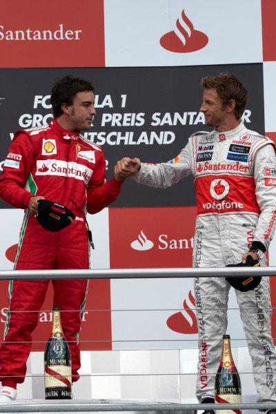 Hockenheimring, Hockenheim, Germany 22nd July 2012 Fernando Alonso, Ferrari, 1st position, and Jenson Button, McLaren, 3rd position, on the podium. World Copyright: Steve Etherington/LAT Photographic ref: Digital Image HC5C5873 copy