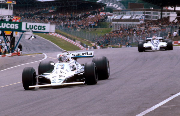 1980 British Grand Prix.Brands Hatch, England.11-13 July 1980.Alan Jones (Williams FW07B Ford) 1st position at Paddock Hill Bend, with Nelson Piquet (Brabham BT49 Ford) behind.Ref-80 GB 17.World Copyright - LAT Photographic