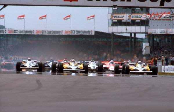 1981 British Grand Prix. Silverstone, England. 16-18 July 1981. Alain Prost and Rene Arnoux (both Renault RE30's) lead at the start. Ref-81 GB 11. World Copyright - LAT Photographic
