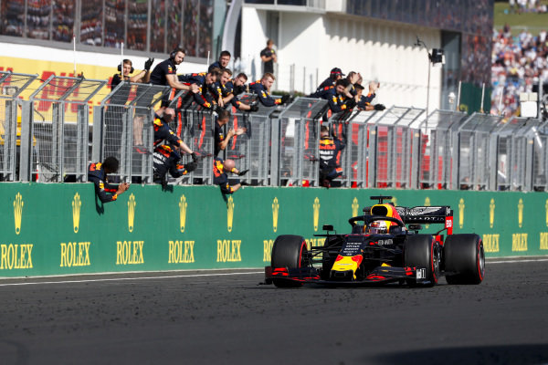 Max Verstappen, Red Bull Racing crosses the finish line
