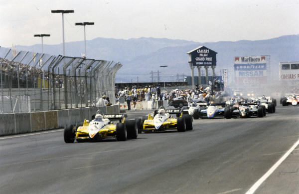 Alain Prost, Renault RE30B, leads René Arnoux, Renault RE30B, Michele Alboreto, Tyrrell 011 Ford, and Eddie Cheever, Ligier JS19 Matra, at the start.