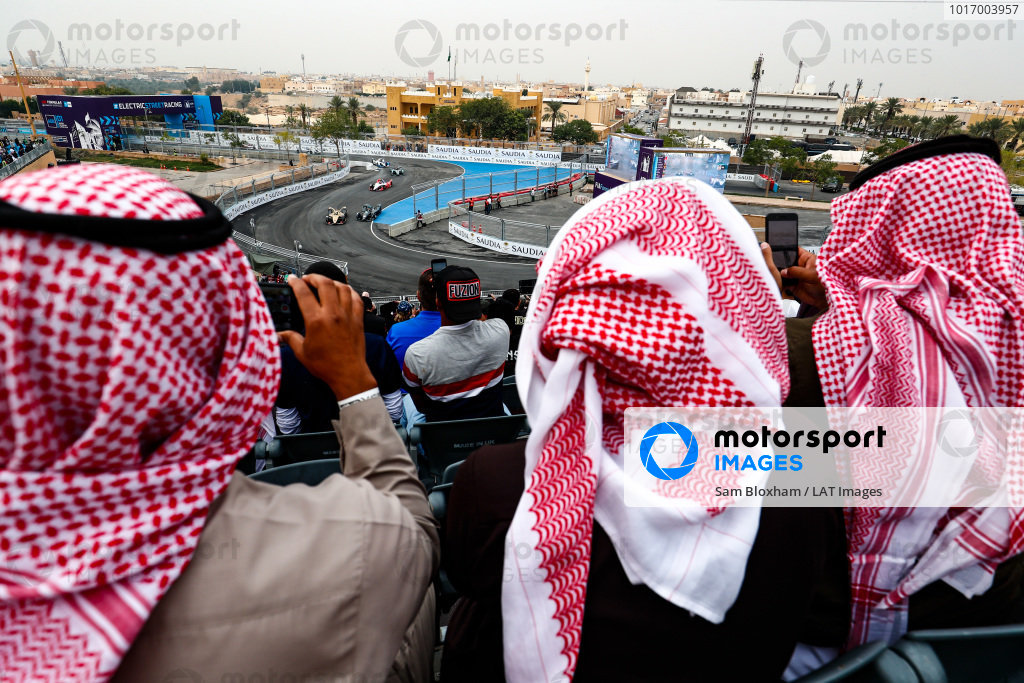 Fans watch the on track action from the grandstand