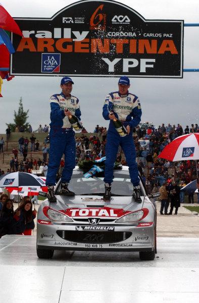 World Rally Championship,  Rally of Argentina, May 16-19, 2002. Richard Burns and Robert Reid spray the champagne. Photo: Ralph Hardwick/LAT