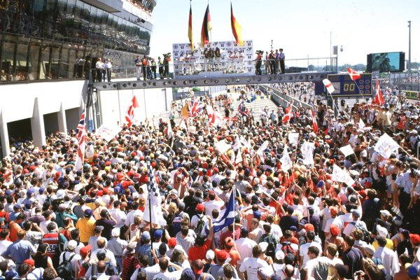2000 Le Mans 24 Hours.Le Mans, France.17-18 June 2000.Frank Biela, Emanuele Pirro, Tom Kristensen and the other Audi drivers celebrate on the podium.World - Bloxham/LAT Photographic